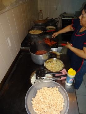 Volunteers Prepare Daily Meal
